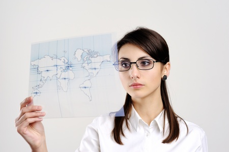 A girl with a map of the world printed on a transparent material Stock Photo - 8761896