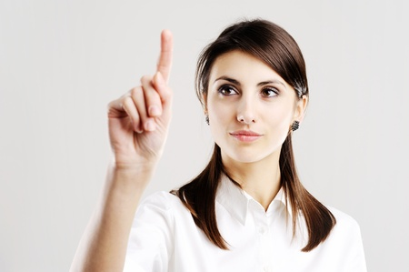 business woman pointing at something on screen Stock Photo