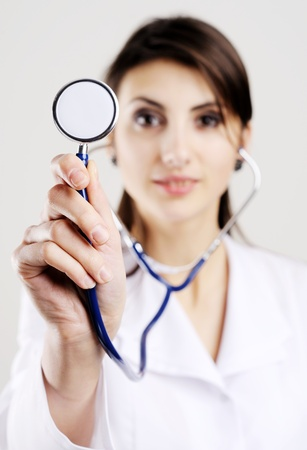 An image of young doctor holding stethoscope to camera Stock Photo - 8761786