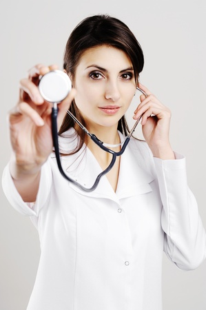 Young female doctor holding stethoscope to camera Stock Photo - 8904123