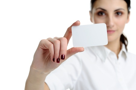 Woman holding businesscard in hand. Focus on card. photo