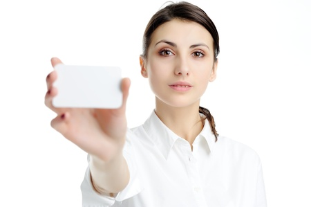 businesscard: Young businesswoman holding blank businesscard in hand