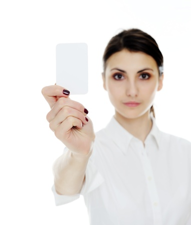 An image of young woman holding blank businesscard in hand. Focus on card  photo