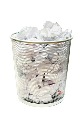 Metal wire wastebasket full of trash on a white background Stock Photo - 8983368