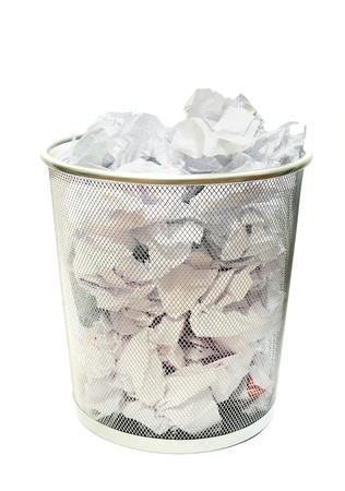 wastebasket: Metal wire wastebasket full of trash on a white background