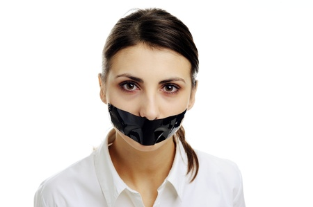 mouth closed: An image of a woman with covered mouth Stock Photo