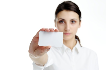 Young businesswoman holding blank businesscard in hand. Focus on card  photo