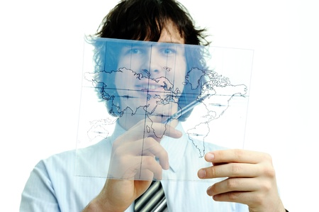 A young man with a map of the world printed on a transparent material Stock Photo - 9182287