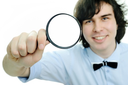 a round of inspection: An image of a young man with a mafnifier