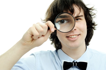 An image of a young man with a magnifier Stock Photo - 9176007