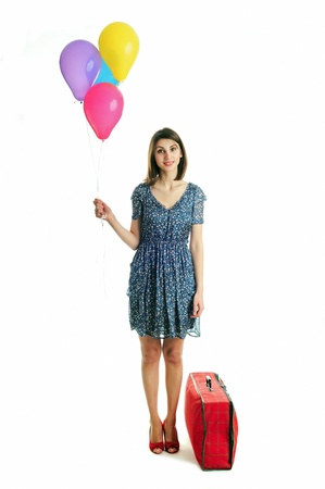 A young beautiful woman with balloons and a bag