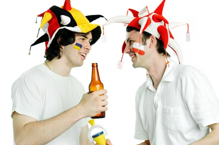 Two football fans with beer shooting in studio photo
