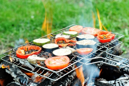 An image of a grill with vegetables on it