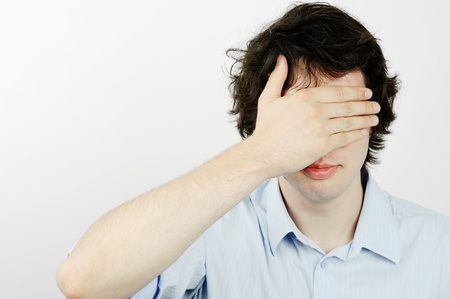 blindly: An image of a young man with his hand on his eyes