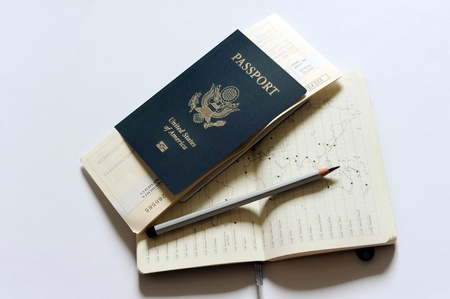 An image of a passport, tickets and a notebook photo