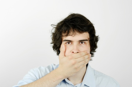 An image of a young man with his hand on his mouth photo