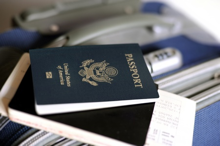 valise: An image of a passport and tickets on a valise