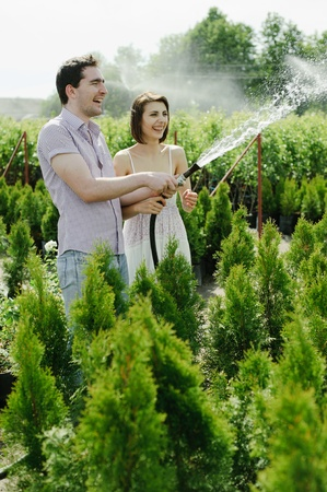 An image of a young couple in the garden photo