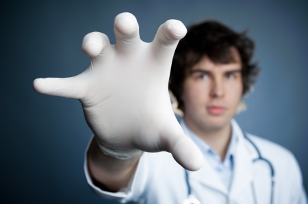 white glove: An image of a hand in a latex glove Stock Photo
