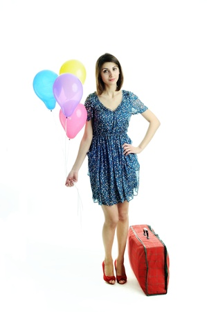 A young beautiful woman with balloons and a bag photo