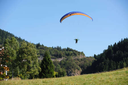 An image of a man flying on a parachute photo