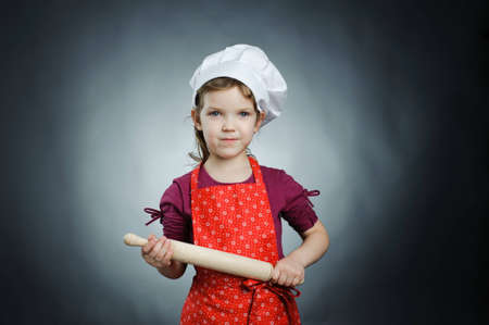 An image of a nice girl in a white hat with a rolling-pin Stock Photo - 13193555