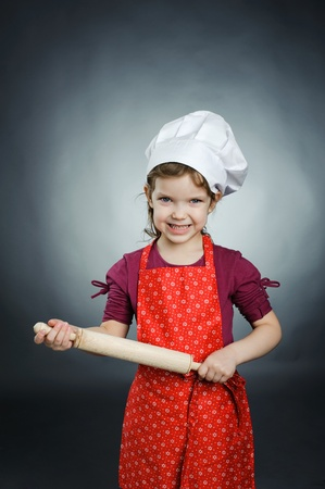 An image of a girl with a rolling pin in her hands photo