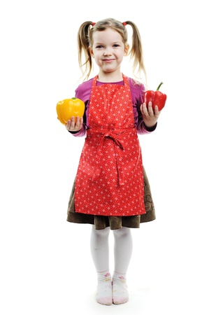 A funny girl with red and yellow paprika Stock Photo - 13193582