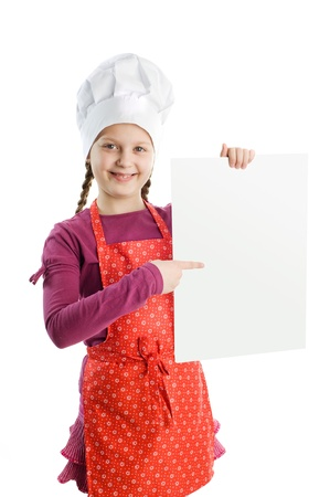 A little chef with a blank sheet of paper photo