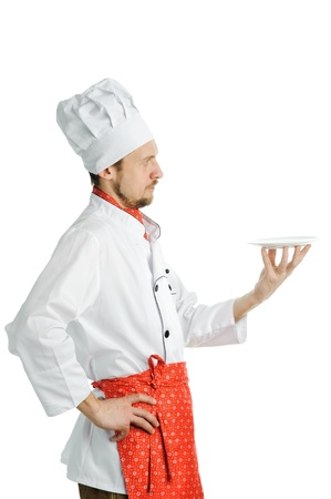 An image of a young chef with an empty dish photo