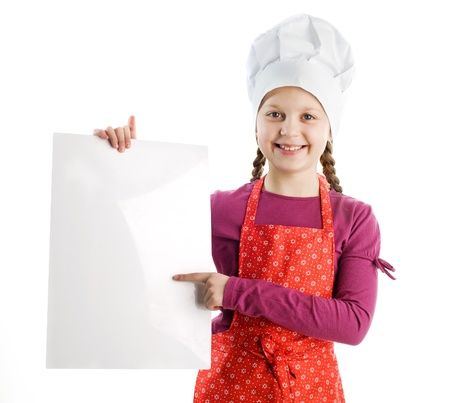 A little nice chef with a blank sheet of paper photo