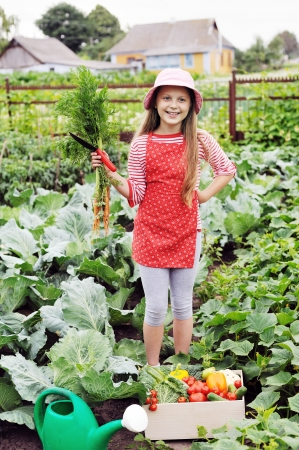 An image of a nice girl in the kitchen-garden photo
