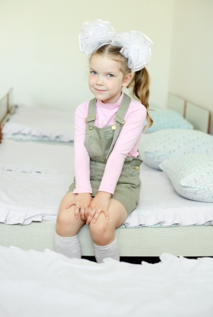 An image of a girl on a bed in the kindergarten photo