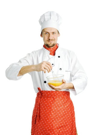 A young chef stirring something in a bowl photo