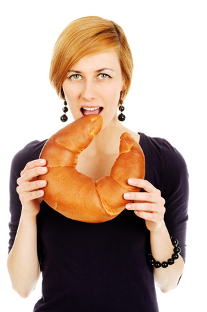 An image of young woman holding bread Stock Photo - 22776948