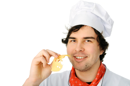 An image of a young happy chef with cheese photo