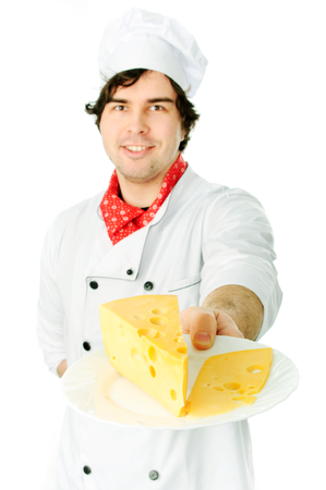 Cook holding a cheese stack. photo