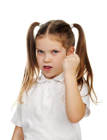 Beautiful sad school girl threatening fist. Stock Photo
