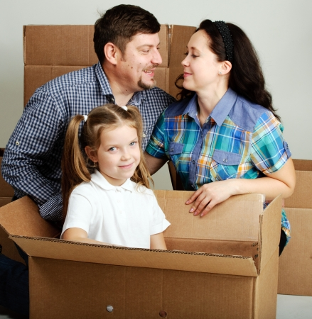 housewarming: Housewarming. Photo of a young family with a boxes