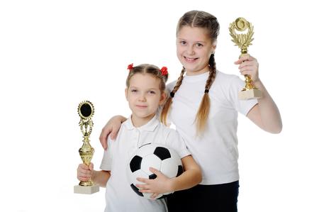 Happy girls holding trophies. photo