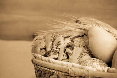 Fresh bread in a basket. Sepia photo