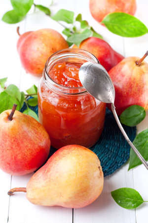 Delicious homemade pears jam with spoon