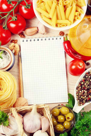 blank recipe book on a table with vegetables Stock Photo