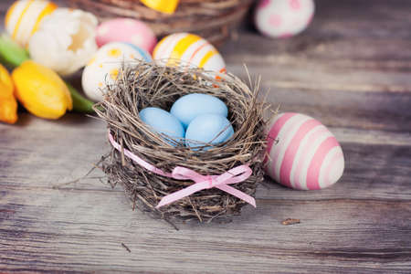 Easter eggs on a wooden background photo