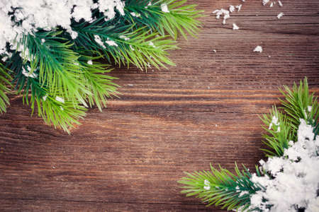 Christmas Fir Tree Border on a wooden surface  Christmas background  photo