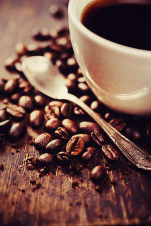 Coffee beans and spoon, details. Shallow depth of field