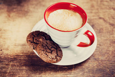 Flavored coffee with chocolate biscuits photo