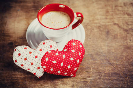 chosen one: Cup of coffee and heart on wooden background. Valentines day. Stock Photo