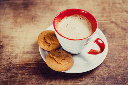 Coffee and  biscuits on wooden board photo