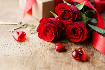 Roses and a red hearts Stock Photo